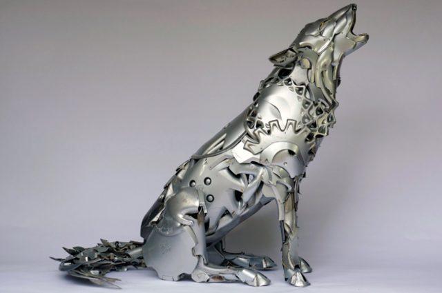 recycled sculpture scrap art green eco recycledart junk rubbish hubcap wolf wolves arctic