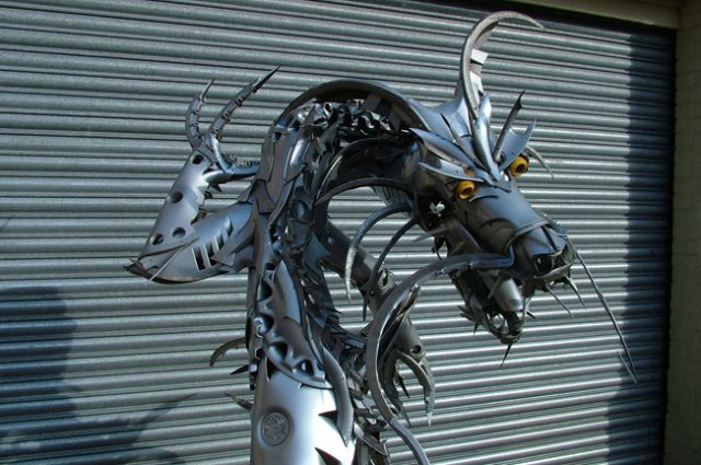 recycled sculpture scrap art green eco recycledart junk rubbish hubcap dragon dragons chinese