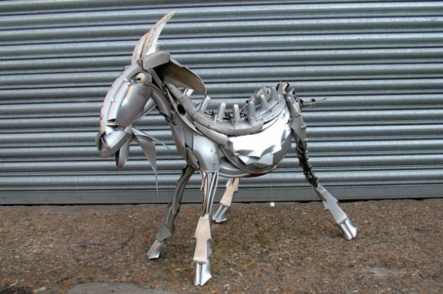 recycled sculpture scrap art green eco recycledart junk rubbish hubcap animal goat goats