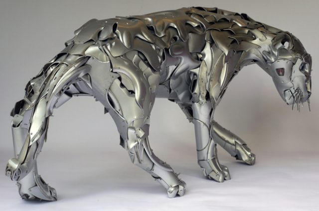 panther big cat cat cats cougar puma recycled sculpture scrap art green eco recycledart junk rubbish hubcap